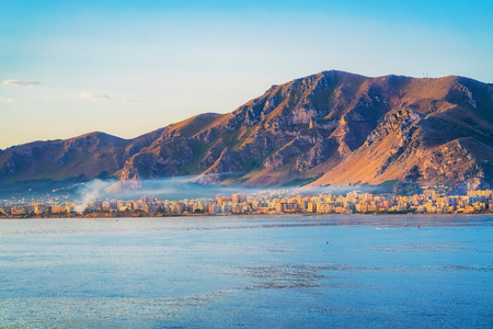 Sunrise at the Mediterranian sea and in Palermo old city, Sicily, Italy