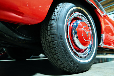 Berlin, Germany - December 11, 2017: Wheel of red Retro Mercedes Benz Gullwing car in the garage in Berlin, Germany