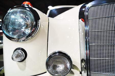 Berlin, Germany - December 11, 2017: Radiator grill of white Retro Mercedes Benz Ponton car in the garage in Berlin, Germany Editorial