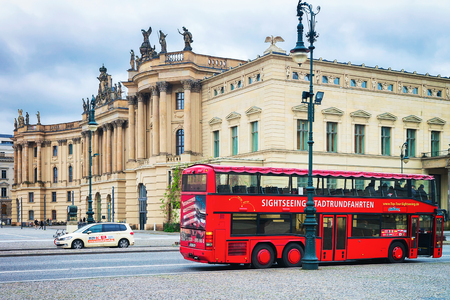 Berlin, Germany - December 12, 2017: Red excursion bus at Humboldt University in Berlin, Germany