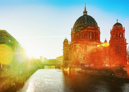 Wonderful sunrise at Berliner Dom Cathedral in Berlin, Germany. Special sun flare Фото со стока