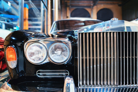 Radiator grill of Black Retro car in the garage in Berlin, Germany