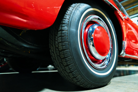 Wheel of red Retro car in the garage in Berlin, Germany