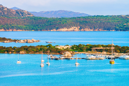 Harbor with boats at Porto Rotondo in Golfo Aranci in Costa Smeralda resort in Mediterranean sea, Sardinia, Italy