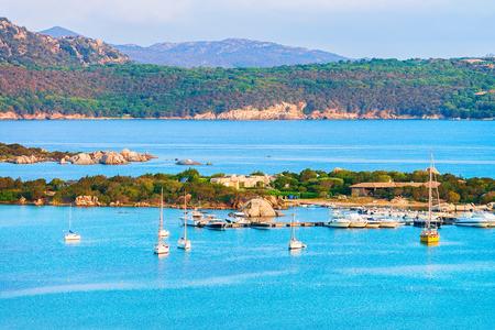 Harbor with boats at Porto Rotondo in Golfo Aranci in Costa Smeralda resort in Mediterranean sea, Sardinia, Italy