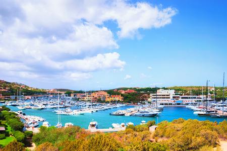 Luxury yachts at harbor of Porto Cervo resort, Costa Smeralda, Sardina in Italy.
