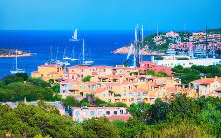 Cityscape with Luxury yachts at marina in Porto Cervo resort, Costa Smeralda Sardina in Italy.