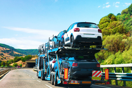 Car transporter on the road in Nuoro, Sardinia, Italy Imagens
