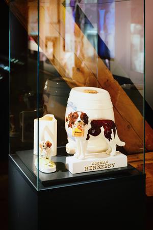 Martigny, Switzerland -  January 1, 2015: Handmade bottle and statues with Saint Bernard dog in breeding kennel and museum in Martigny, Switzerland Editorial