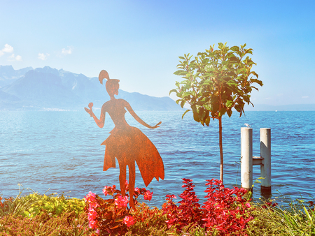 Figure of a woman on promenade of Geneva Lake in Montreux, Vaud canton, in Switzerland