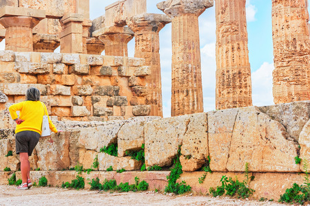 Woman at Doric temple of Hera at Selinunte in Sicily, Italy