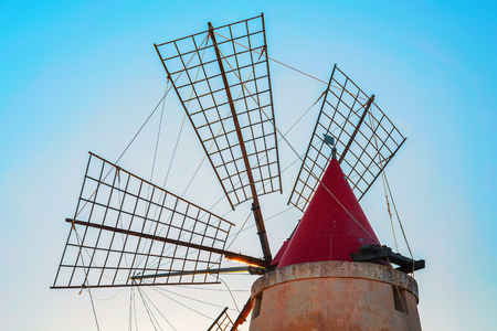 Windmill in the salt evoporation pond in Marsala, Sicily island, Italy
