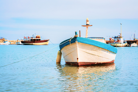 Boat at Cefalu port in the Mediterranean sea, Palermo region, Sicily island in Italy
