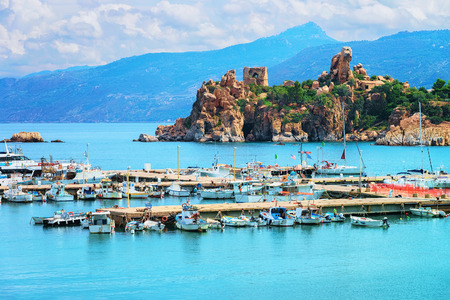 Cefalu port and Old castle ruins in the Mediterranean sea, Palermo region, Sicily island in Italy Stock Photo