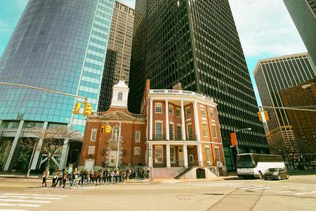 New York, USA - April 25, 2015: James Watson House of Financial District of Manhattan, New York City, the USA. Tourists are crossing the street. Toned