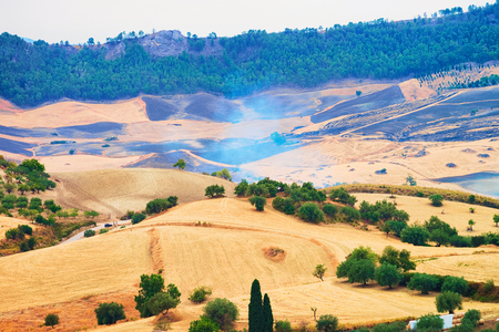 Landscape of valley with fires in fields in Enna province, Sicily, Italy Stock Photo