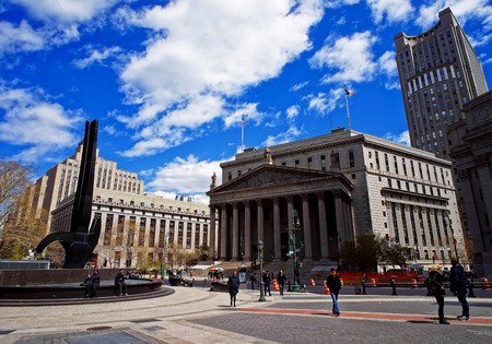 New York, USA - April 24, 2015: Tourists in the street and New York State Supreme Building in spring, or New York County Courthouse, in Lower Manhattan, New York, the USA.