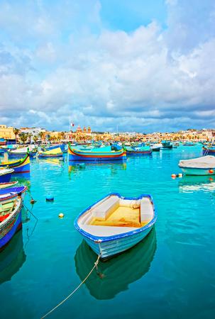 Luzzu colorful boats in Marsaxlokk harbor, the bay of the Mediterranean sea, Malta island Stok Fotoğraf
