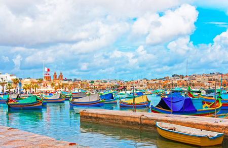 Luzzu colorful boats at Marsaxlokk Port of the bay of the Mediterranean sea, Malta island