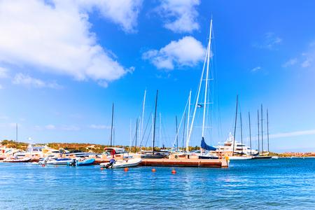 Sea and Luxury yachts in marina of Porto Cervo resort, Costa Smeralda Sardinia in Italy. Stock Photo