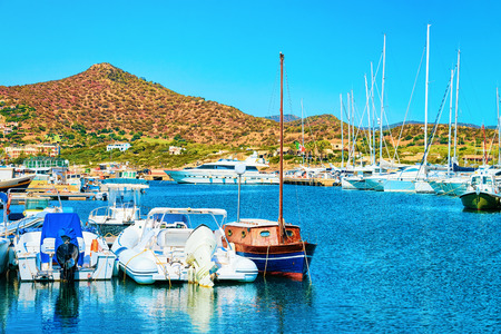 Port with ships and yachts, Villasimius, in South Sardinia, in Italy Stockfoto