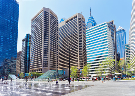 Philadelphia, USA - May 4, 2015: Penn Square and street fountain and skyline of skyscrapers. Tourists on the square, Philadelphia. Pennsylvania, USA. Editorial
