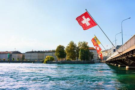 Geneva, Switzerland - August 30, 2016: Geneva Lake with Mont-Blanc bridge and many flags, Geneva, Switzerland. People on the background
