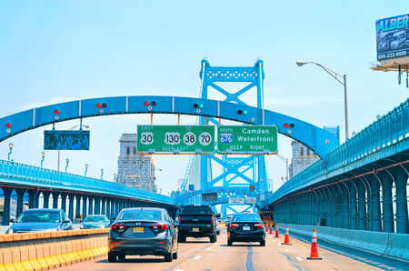 Philadelphia, USA - May 5, 2015: Cars in Benjamin Franklin Bridge in New Jersey, America Editorial