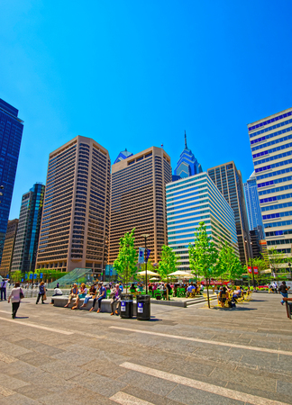 Philadelphia, USA - May 4, 2015: Penn Square with street skyline of skyscrapers in Philadelphia. Tourists on the square. Pennsylvania, USA. Editorial