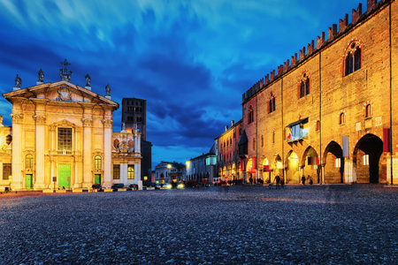 People at Church of Sant Andrea in Piazza Mantegna Square in Mantua, Lombardy, Italy. Late in the evening