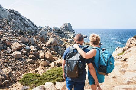 Couple looking at the Sea and rocks at Capo Testa, Santa Teresa Gallura, Sardinia, Italy