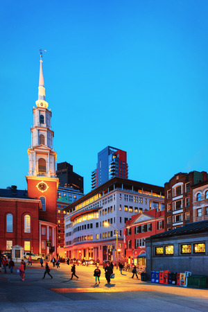 Boston, USA - April 29, 2015: Boston Common public park, downtown Boston, Massachusetts, the United States. Park Street Church and People on the background. Late in the evening