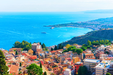 Cityscape of Taormina and the Mediterranean Sea, Sicily, Italy Фото со стока