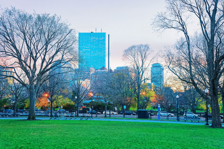 Skyline and Boston Common public park of downtown Boston, Massachusetts, the United States. People on the background. Late in the evening Stock Photo - 101978685