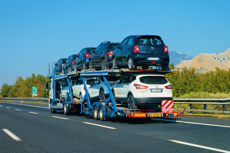 Rome, Italy - October 4, 2017: Car carrier at the road. Truck transporter