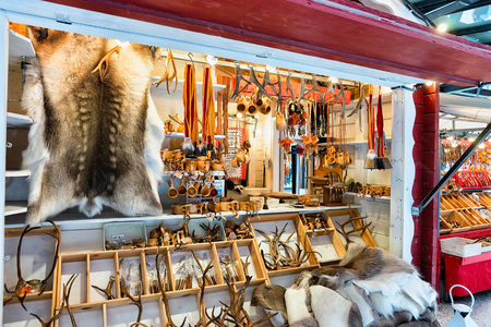 Rovaniemi, Finland - March 2, 2017: Winter Saami Souvenirs such as reindeer fur and horns at Finnish Christmas Market in Rovaniemi, Finland, Lapland. At North Arctic Pole.