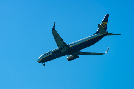 Rome, Italy - October 4, 2017: Ryanair Plane flight in the blue sky. Aircraft travel concept Editorial