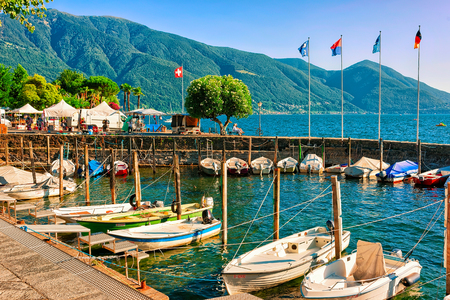 Ascona, Switzerland - August 23, 2016: Boats at the promenade of the luxurious resort of Ascona on Lake Maggiore in Ticino canton in Switzerland. Redakční