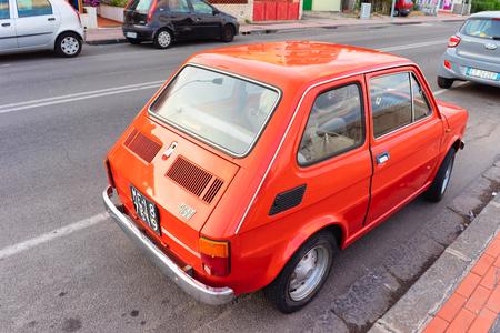Santa Teresa di Riva, Italy - September 24, 2017:  Red old Fiat 126 car in the road in Santa Teresa di Riva at Messina, Sicily, Italy Editorial