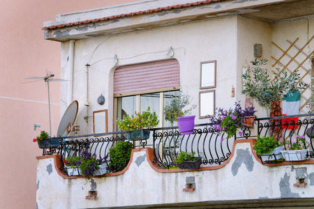 Balcony with flowers in Santa Teresa di Riva near Messina, Sicily, Italy