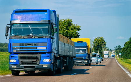Wood carrier vessel on the road in Poland. Lorry transport delivering some freight cargo.