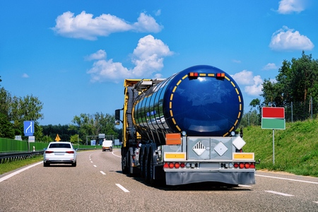 Truck tanker in the road of Poland. Lorry transport delivering some freight cargo. 스톡 콘텐츠