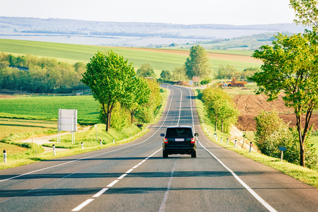 Scenery with Car on road in South Moravia, Czech Republic.