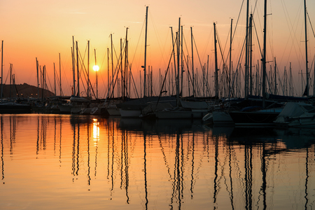 Romantic sunset at the ships in marina in Izola village on the Adriatic sea, Slovenia