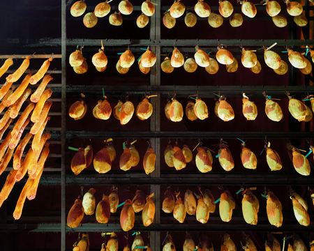 Hanging traditional cured french meat at ripening cellar in Franche Comte