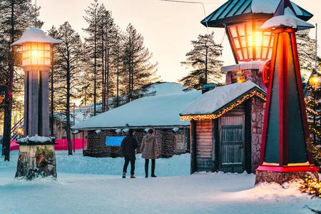 Couple in Santa Claus Village in Rovaniemi in Lapland in Finland.