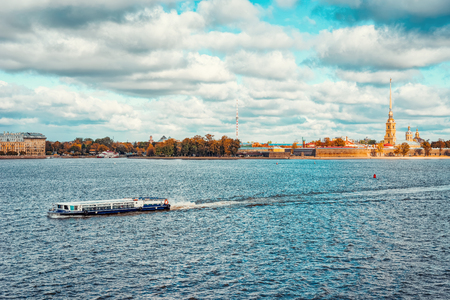 Excursion ferry with Neva River and Peter and Paul Fortress in St Petersburg, in Russia.