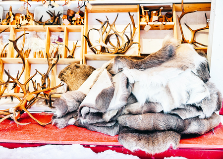 Market stall with traditional souvenirs such as reindeer skin and horns at winter Finland in Lapland in winter. Stock Photo