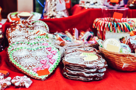 Gingerbreads in a heart and monkey shapes displayed for sale at the Christmas market in winter Riga in Latvia.