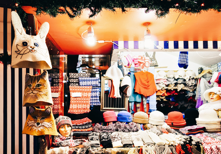 Warm colorful hats, mittens, gloves and socks at one of the stalls at the street Christmas market in winter Riga in Latvia. Stock Photo - 115764253